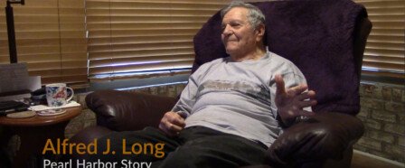 Al Long sits in his chair and recounts stories of WW2